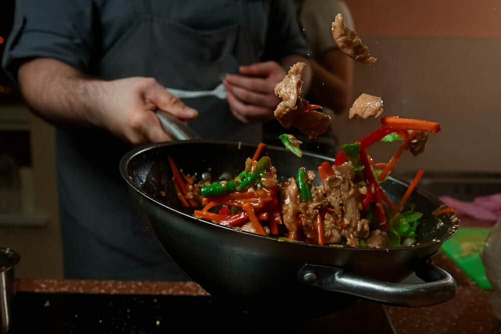 Wok with chili peppers and chicken