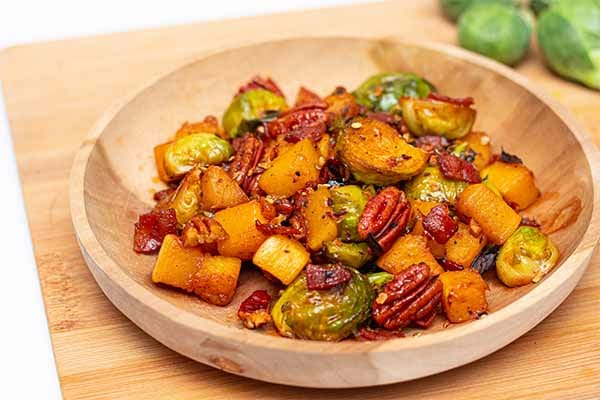Sweet and Spicy Roasted Brussel Sprouts and Butternut Squash topped with Habanero Flakes